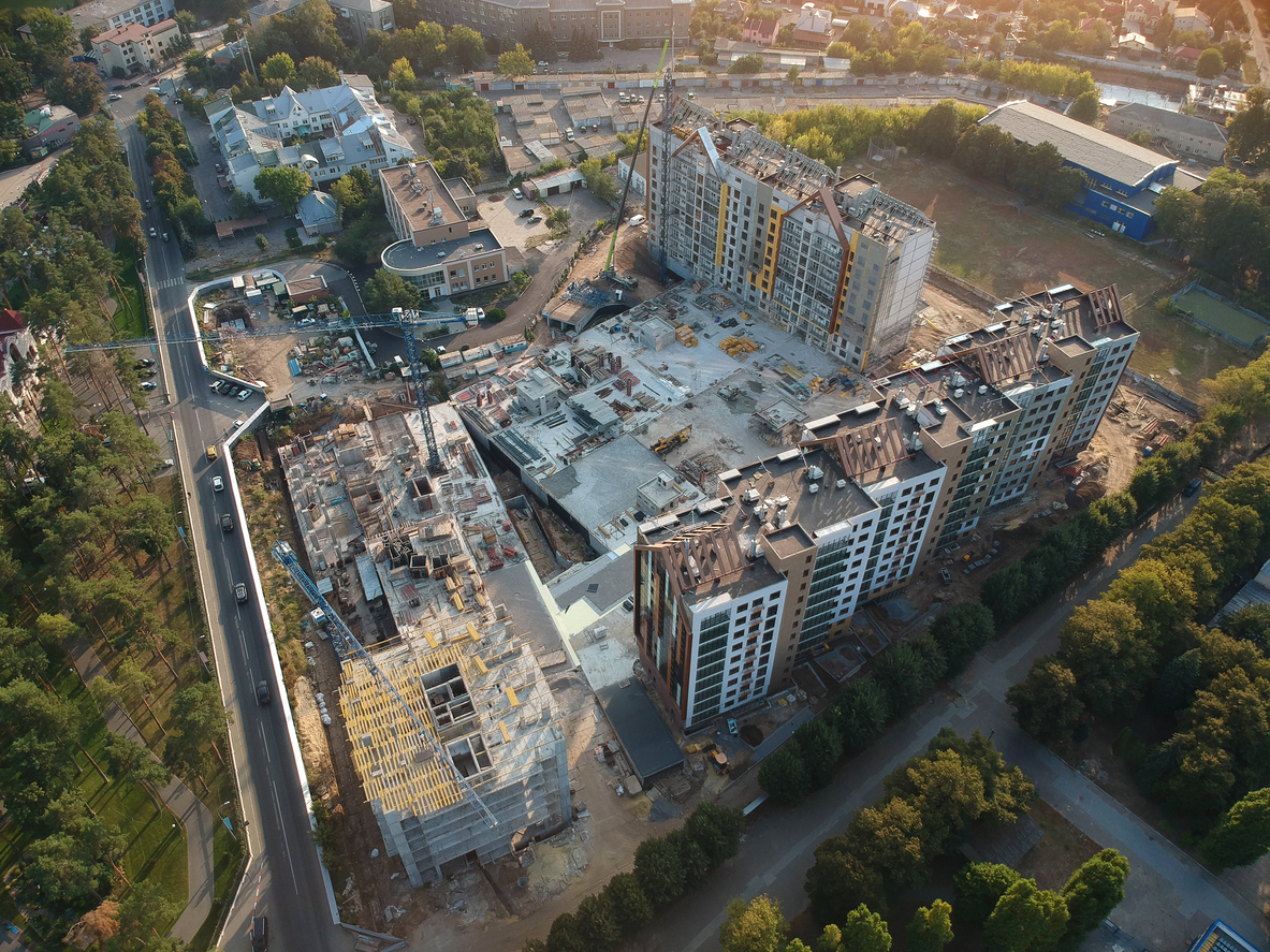 New private housing development construction in the city aerial view. Drone photo.