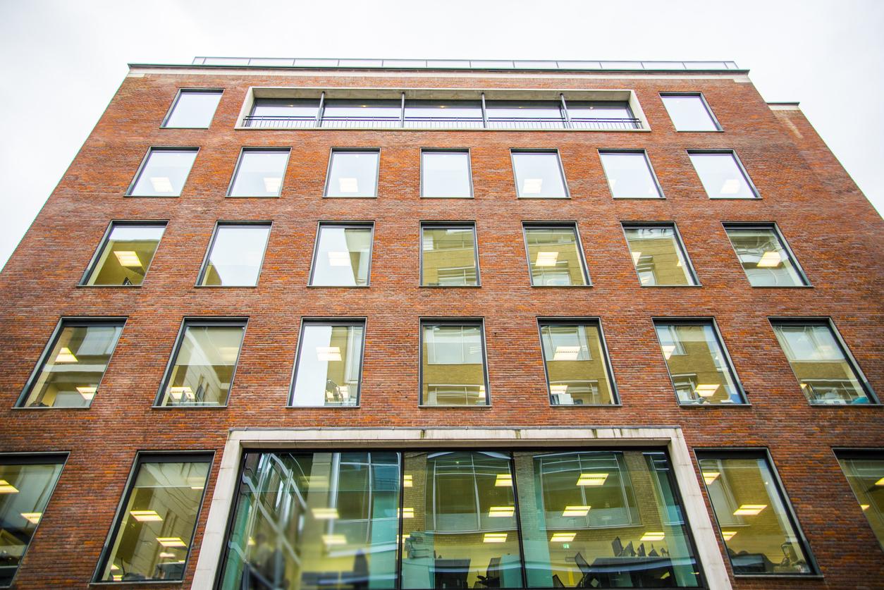 A block of offices with a brick exterior facade.