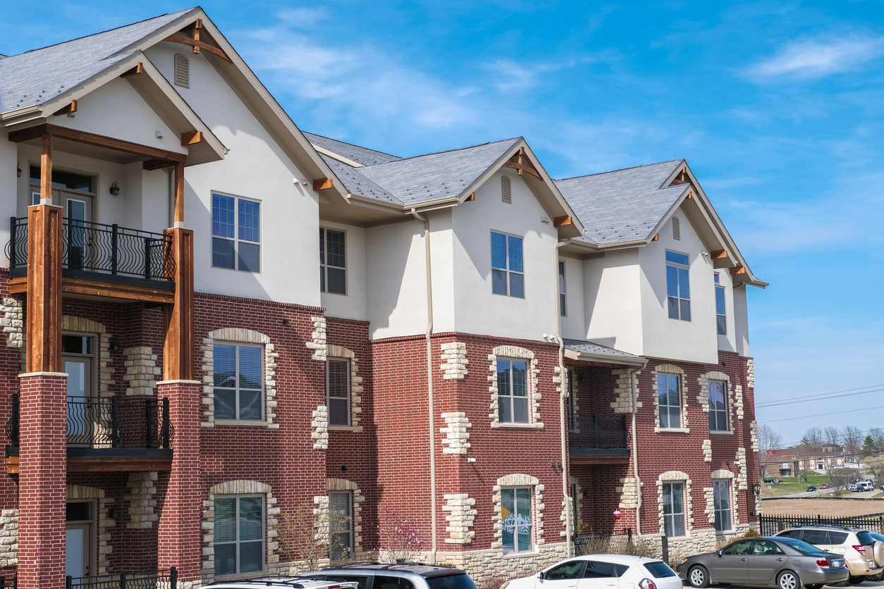 Multifamily building in a Midwestern town, USA; parked cars by the building